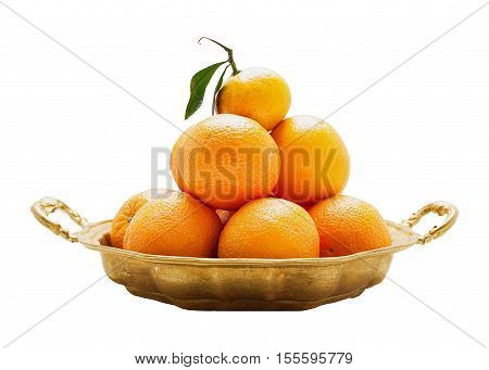 Oranges on a round platter isolated on white