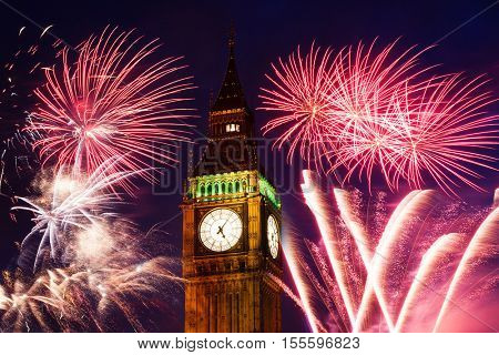 explosive fireworks around Big Ben. New Year's Eve celebration background