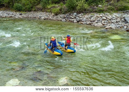Rafting on a catamaran on the mountain river