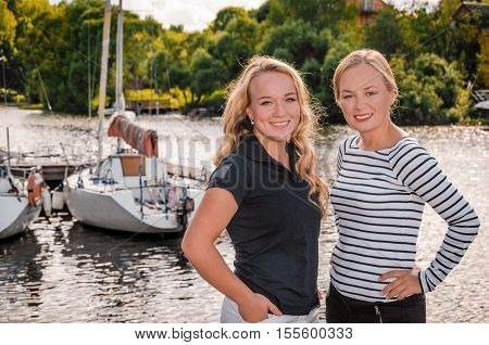 Girl - sailor.Smiling girl on yacht. Lady in suglasses holding drink. Living a happy life.