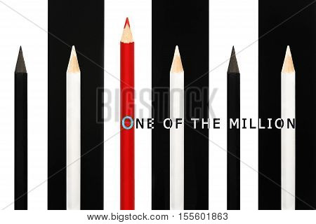 Red Pencil Standing Out From Crowd Of Black And White Fellows On B/w Stripe Background. Business Suc