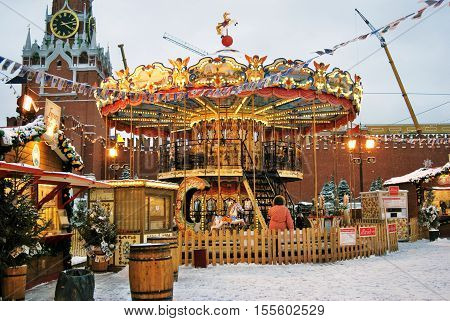 MOSCOW - JANUARY 19, 2016: Christmas fair and decorations on the Red Square in Moscow, color photo. Red Square is a popular touristic landmark.