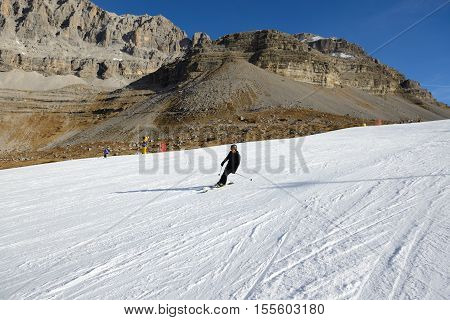 MADONNA DI CAMPIGLIO ITALY - DECEMBER 18: The ski and skier at Passo Groste ski area on December 18 2015 in Madonna di Campiglio Italy. More then 46 mln tourists is expected to visit Italy in year 2015.