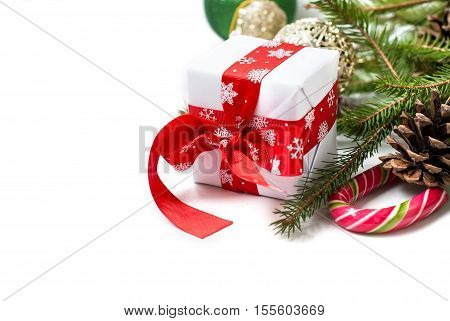 Gift Box Tied With A Red Ribbon , Fir Branches,candy And Christmas Ball