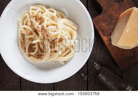 Cacio e pepe, italian vermicelli or spaghetti pasta with cheese and pepper