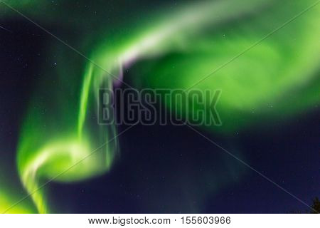 A bright flash of Northern lights in the night sky