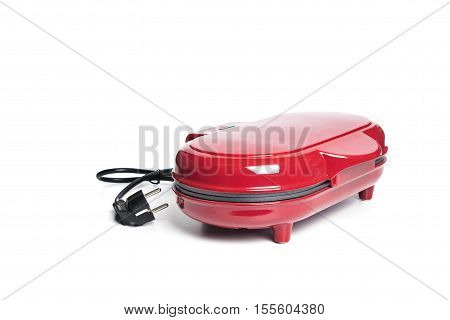 Red sandwich maker on white background.home tools