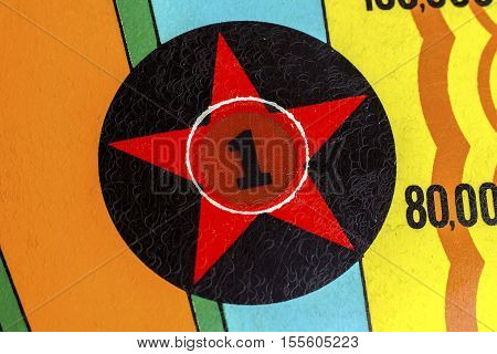Number 1 star decal light on pinball machine