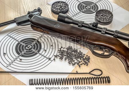 air gun with bullets targets on table
