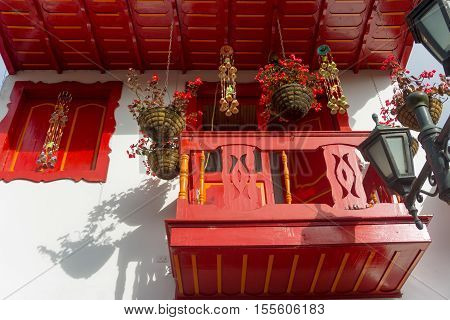 Red colonial balcony and flowers in Salento Colombia