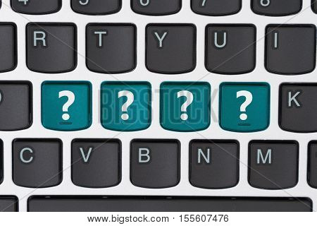 Searching for answers online A close-up of a keyboard with teal highlighted text ????