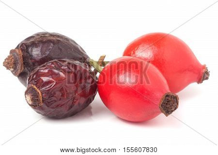 a dried and fresh rose hip berry isolated on white background.