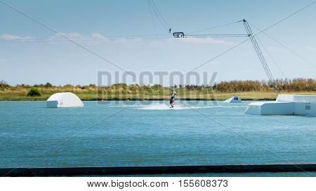 Wakeboarder Is Exerted On The Lake To Make Figures
