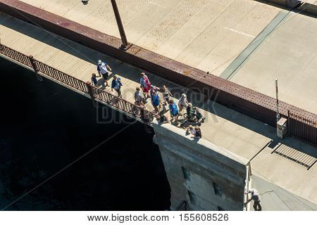 Chicago, USA - May 30, 2016: Aerial view of people walking on DuSable bridge in downtown