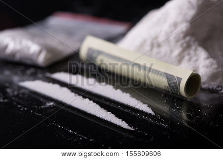 Rolled Hundred Dollars Banknote, Two Lines And Pile Of Cocaine On Black Background