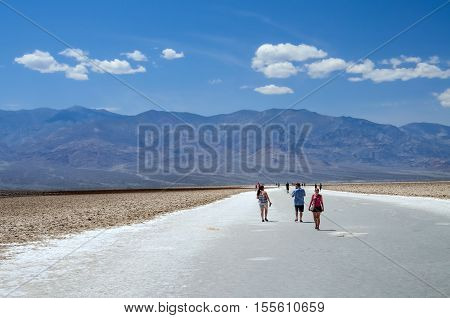 Stovepipe Wells, USA - May 8, 2014: Badwater basin in Death Valley National Park, California, USA with people walking on salt flats