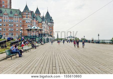 Quebec City, Canada - July 27, 2014: People walking on boardwalk of Dufferin Terrace by Chateau Frontenac