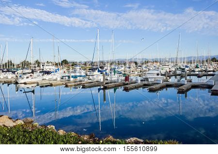 Boats dock and marina with reflection at harbor in Oxnard, California
