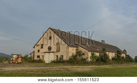 Building for cow in Roprachtice village in summer time