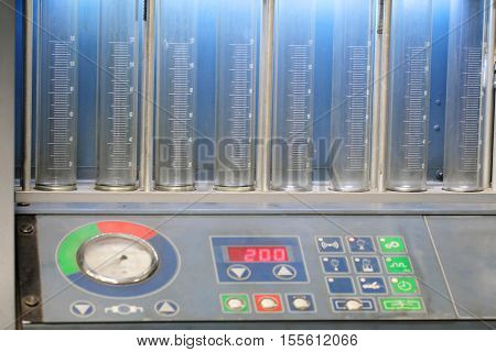 The image of a car's injector diagnostic and repair machine close up