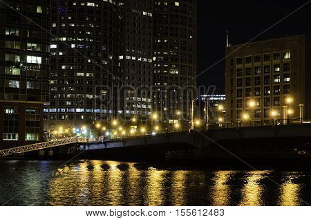 Boston Massachusetts USA - October 20 2016: Pre-dawn view across Fort Point Channel toward Seaport Blvd and Boston financial district
