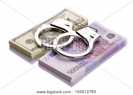 Pair Of Handcuffs Closeup On Dollar And Euro Banknotes Stacks