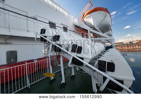 Lifeboats On Upper Deck Of Cruise