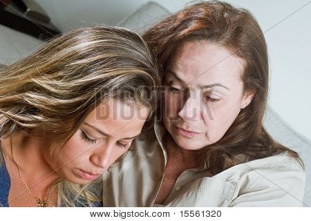 Bad News for mom and daughter Indoors Portrait