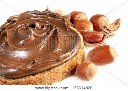 Bread with sweet chocolate hazelnut spread isolated on white background