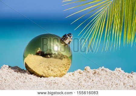 Yellow Fir Tree Decoration Ball On Sandy Beach