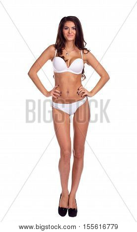 Expensive and beautiful lingerie on attractive brunette girl, isolated on white background. poster