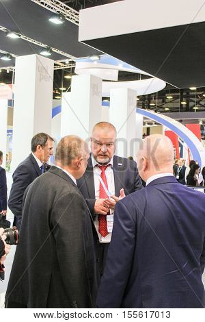 St. Petersburg, Russia - 4 October, Communication of business people on the forum, 4 October, 2016. Petersburg Gas Forum which takes place in Expoforum.