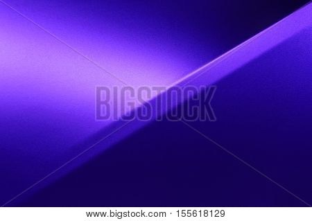 Fragment of violet steel car bodywork, vehicle silver paint coating texture, selective focus, abstract