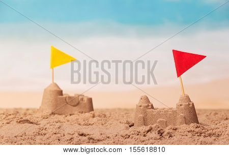 Sandcastles with checkboxes close-up on a background of the sea.
