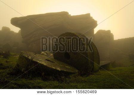 Millstones in a misty sunrise, on Stannage Edge