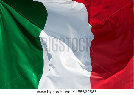 full framed italian flag floating in the wind exact colors