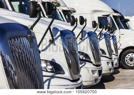 Indianapolis - Circa November 2016: Navistar International Semi Tractor Trailer Trucks Lined up for Sale II
