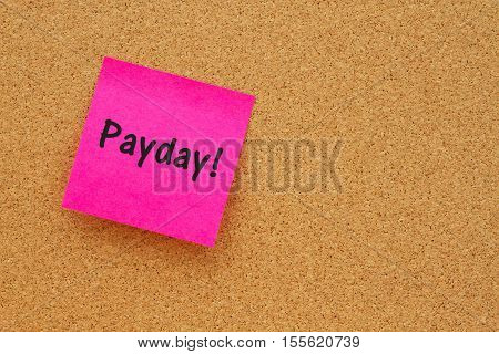 Reminder it is payday message Bulletin board with a blank sticky note with text Payday