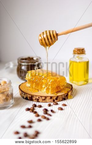 homemade cosmetics based on honey and coffe wooden background