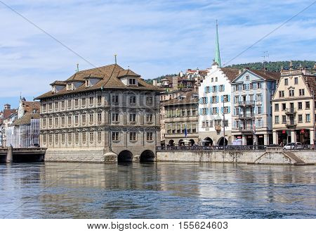 Zurich, Switzerland - 25 May, 2016: Zurich Town Hall and historic buildings along the Limmat river. Zurich Town Hall houses the Zurich Cantonal Parliament and the Zurich City Parliament.