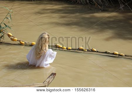 Jericho, Israel - November 1, 2016: Young Woman at the Baptism Site called Qasr el Yahud. Its located at Jordan River in the Region of the West Bank in Israel