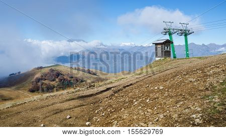 STRESA, PIEDMONT, ITALY. 27th OCTOBER 2016. A ski-lift stands redundant on the snowless slopes of Mottarone, Piedmont, Italy.