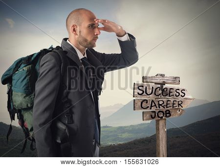 Businessman with explorer backpack follows the directional arrows