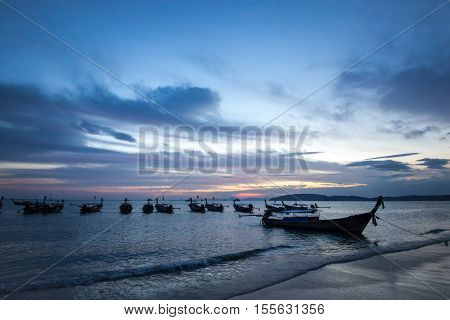 Traditional thai longtail boat at sunset Ao Nang Beach. Thailand, Krabi province.