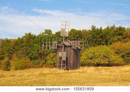 Antique ramshackle wooden windmill in Pirogovo. Kiev Ukraine