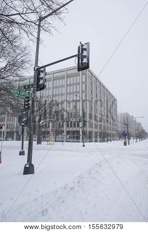 Washington D.C. USA - January 23 2016: Snow-covered empty crossroad during a snowstorm.