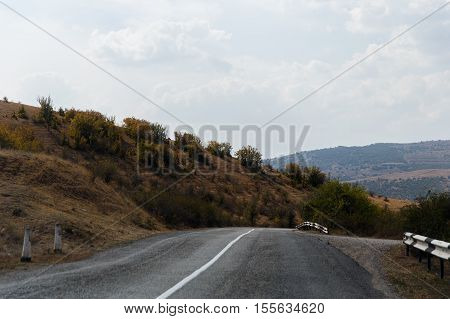 Russian .Crimea. Sudak. Mountain road with fence . 14.09.2016