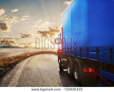 Blue truck on the road with the landscape at sunset. 3D Rendering