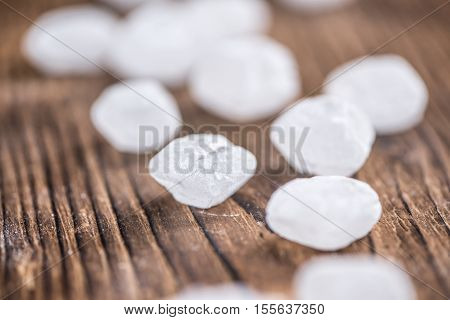 White Rock Candy On Wooden Background