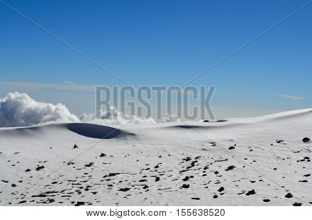 Snow covered landscape with snow and ice and blue sky